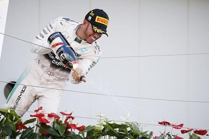 Japanese GP: Lewis Hamilton beats Nico Rosberg after first-lap dice