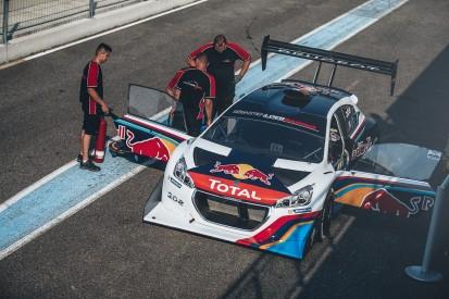 Sebastien Loeb receives his Pikes Peak Peugeot 208T16