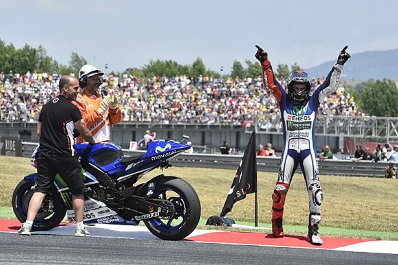 Barcelona MotoGP: Lorenzo fends off Rossi, Marquez crashes again