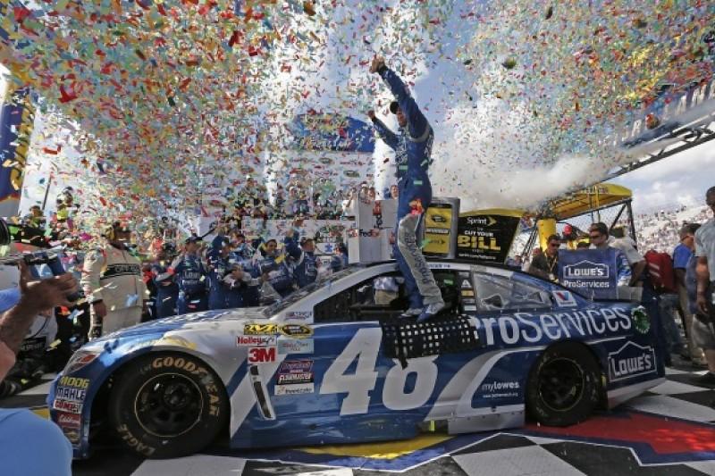 Dover NASCAR: Jimmie Johnson denies Kevin Harvick victory