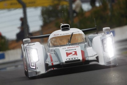 Spinning the (fly)wheel: Audi's quest for hybrid history