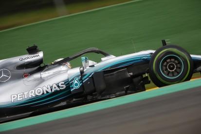 Belgian GP: Hamilton beats F1 title rival Vettel to pole in wet Q3