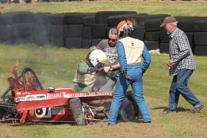 Historic FFord racer saved by spectators, driver in fiery crash