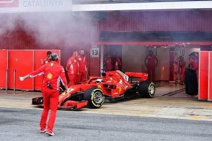 What was behind Ferrari-powered cars' smoking during F1 testing?