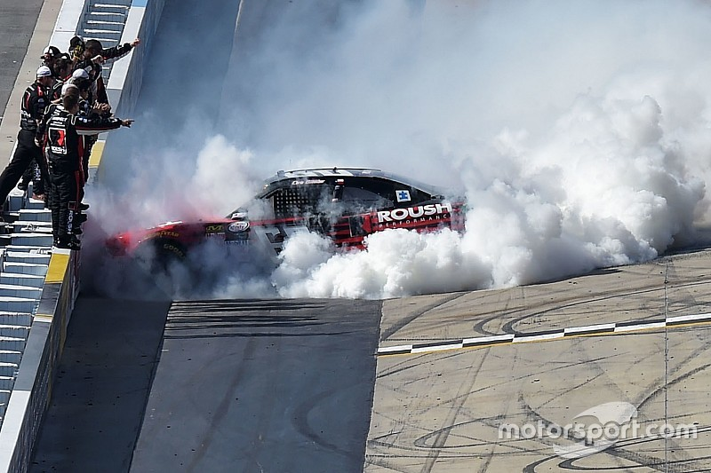 Buescher pushes past teammate to take Dover victory