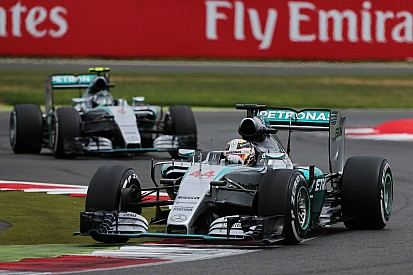 Hamilton claims emotional home win with Rosberg in second
