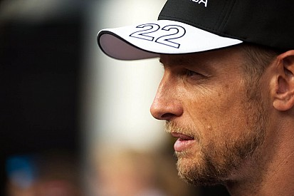 Penalised Button resigned to tough race