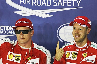 """Singapore Grand Prix: Vettel takes his first pole in """"red"""""""