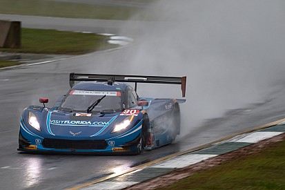 Soggy Petit takes dripping-wet green flag