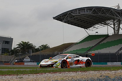 McLaren GT factory driver Rob Bell helps secure victory in the heat of Sepang