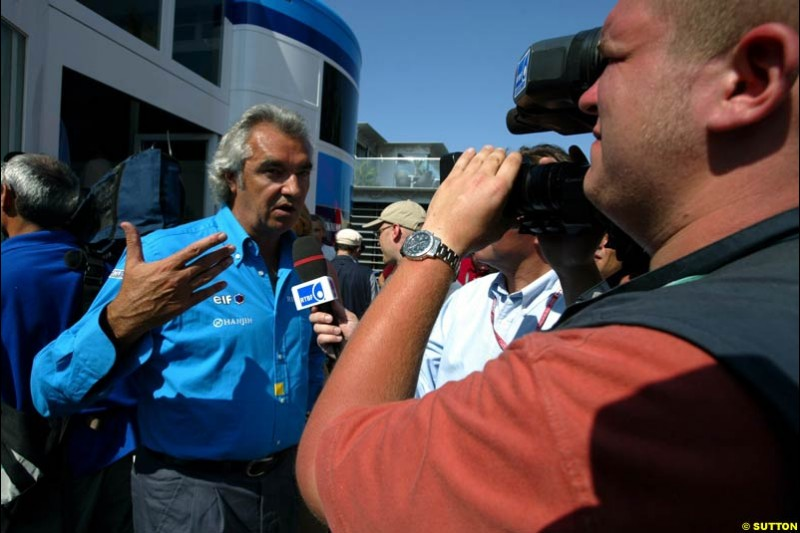 Renault boss Flavio Briatore comments on the team's 2003 drivers line up. Saturday, French Grand Prix, Magny Cours, France, July 20th 2002.