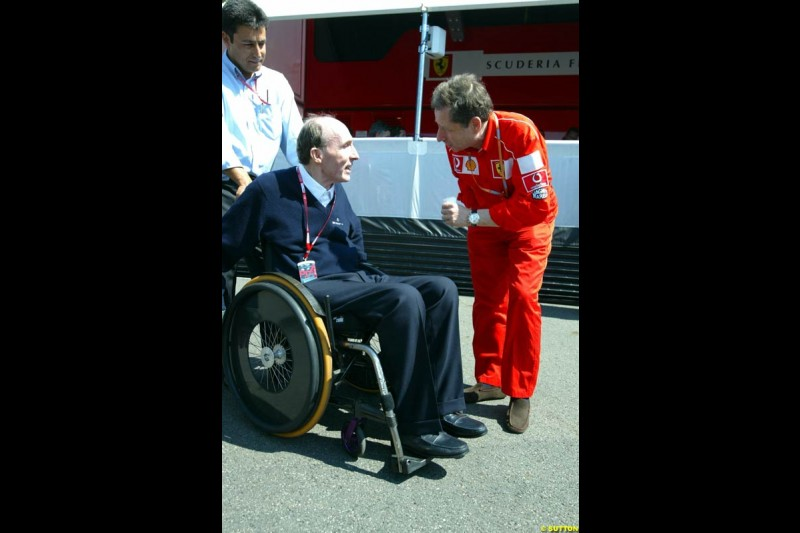 Frank Williams chats with Ferrari's Jean Todt. Saturday, French Grand Prix, Magny Cours, France, July 20th 2002.