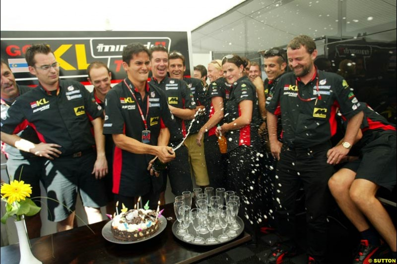 The Minardi team celebrates Alex Yoong's 26th birthday. Saturday, French Grand Prix, Magny Cours, France, July 20th 2002.