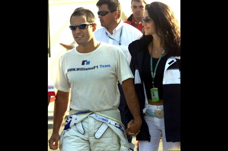 Juan Pablo Montoya and girlfriend Connie, after he set the 6th pole of the year. Qualifying, French Grand Prix, Magny Course, France, July 20th 2002.