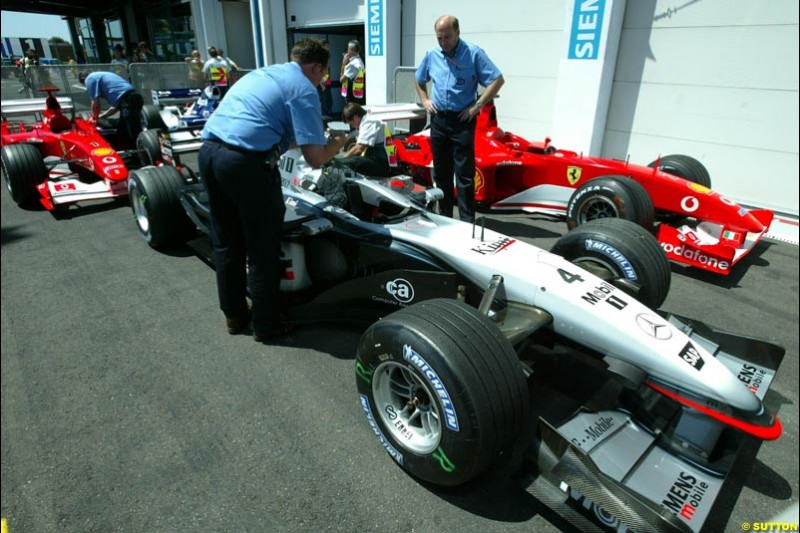 Parc Ferme, Qualifying for the French Grand Prix, Magny Cours, France, July 20th 2002.