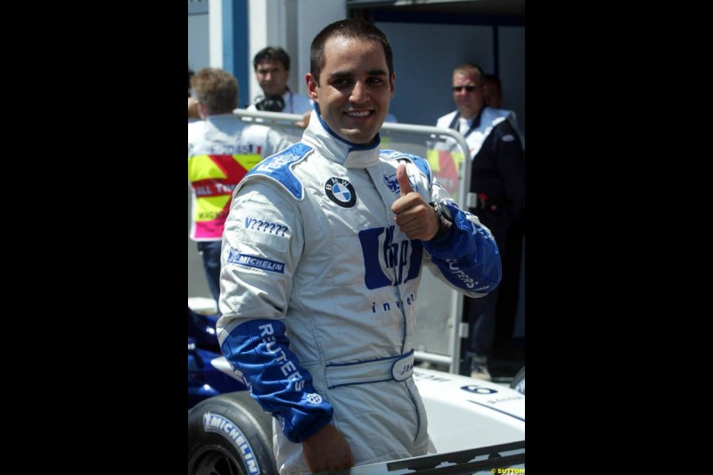 Juan Pablo Montoya after setting his 6th pole of the year. Qualifying for the French Grand Prix, Magny Cours, France, July 20th 2002.