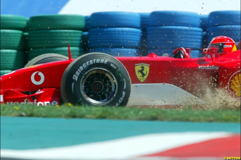 Michael Schumacher, Ferrari, makes a mistake. Qualifying for the French Grand Prix, Magny Cours, France, July 20th 2002.