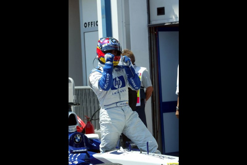 Juan Pablo Montoya, Williams, after setting his 6th pole position of the year. Qualifying for the French Grand Prix, Magny Cours, France, July 20th 2002.