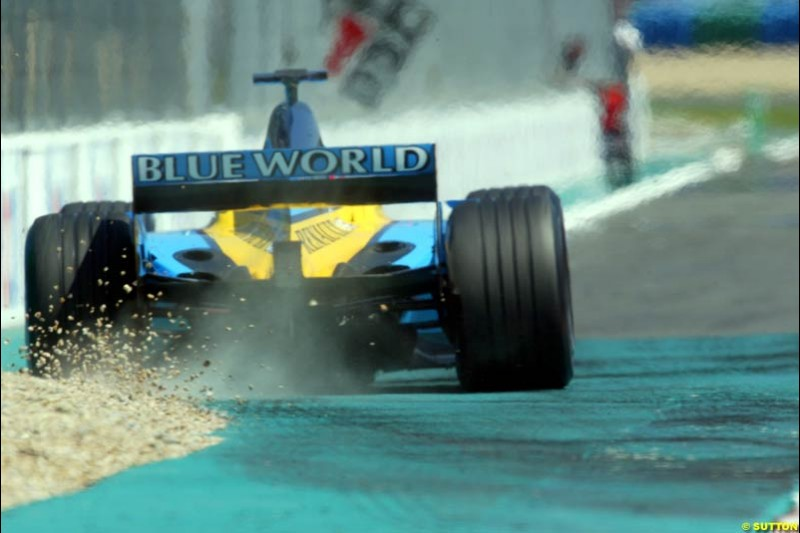 Jarno Trulli, Renault, has a small off. Qualifying for the French Grand Prix, Magny Cours, France, July 20th 2002.