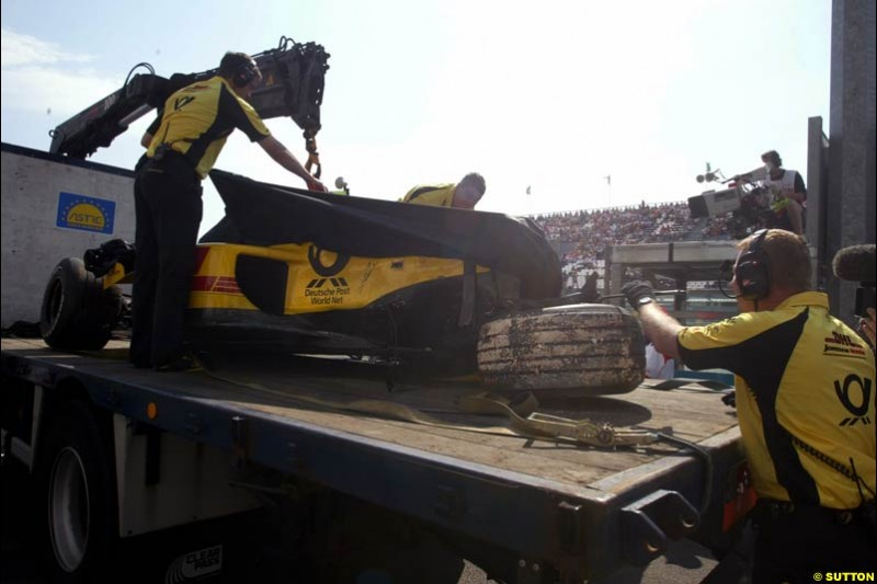 Jordan's Giancarlo Fisichella's car lifted after his crash. Saturday Free Practice, French Grand Prix, Magny Cours, France, July 20th 2002.