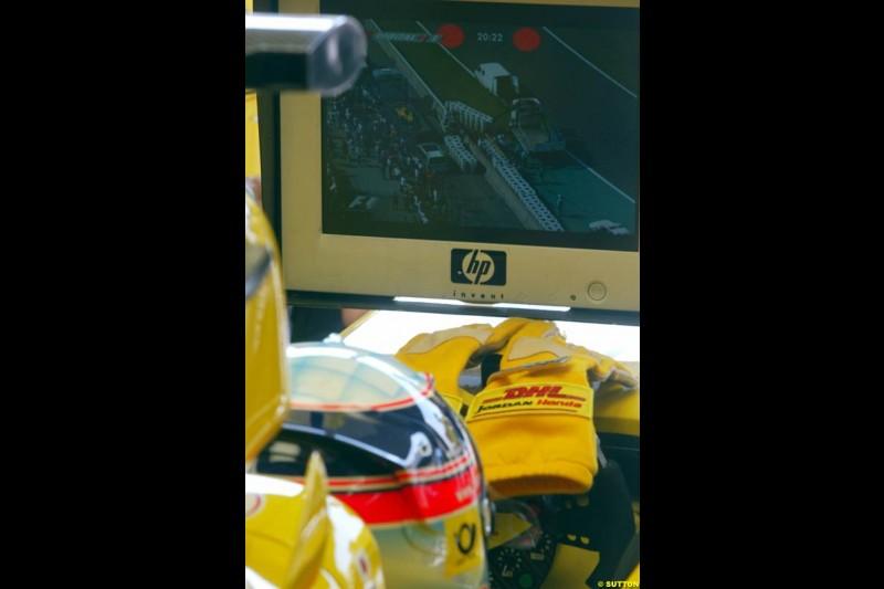 Jordan's Takuma Sato watches teammate Giancarlo Fisichella crash. Saturday Free Practice, French Grand Prix, Magny Cours, France, July 20th 2002.