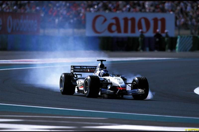 Kimi Raikkonen locks up. French Grand Prix, Magny Cours, France, July 21st 2002.