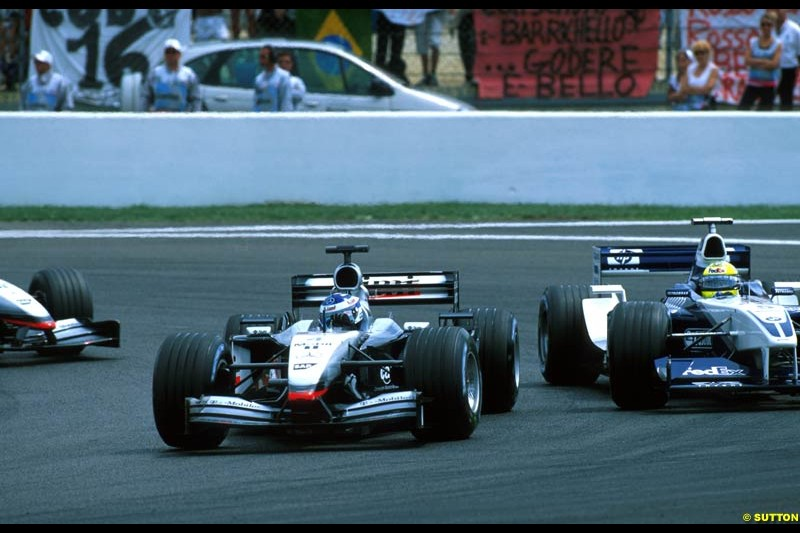 Kimi Raikkonen, McLaren and Ralf Schumacher, Williams BMW FW24, fight for position. French Grand Prix, Magny Cours, France, July 21st 2002.