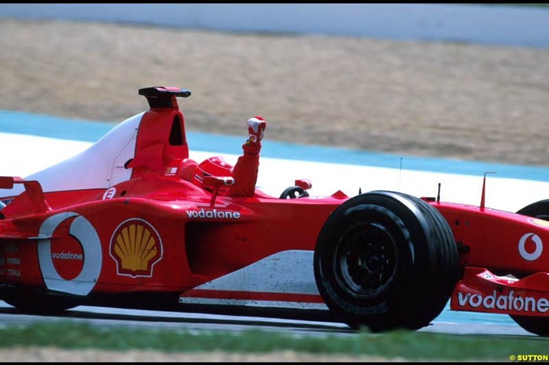 Michael Schumacher celebrates victory. French Grand Prix, Magny Cours, France, July 21st 2002.