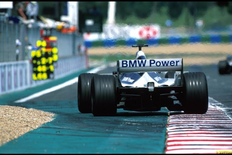 A Williams BMW FW24 crosses the start/finish line. French Grand Prix, Magny Cours, France, July 21st 2002.