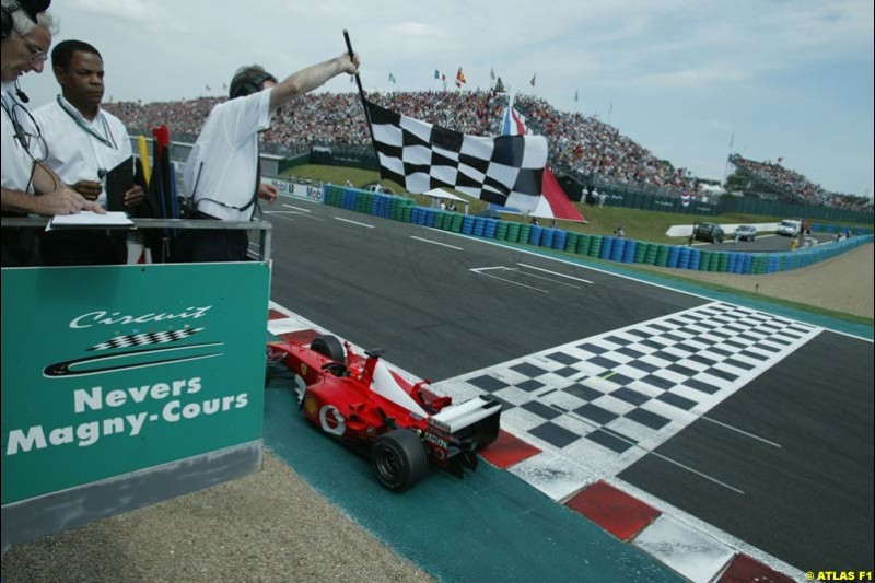 Schumacher takes the chequered flag. French Grand Prix, Magny Cours, France, July 21st 2002.