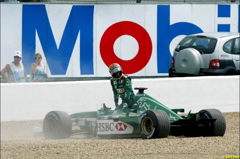 Eddie Irvine, Jaguar, retires from the French Grand Prix, Magny Cours, France, July 21st 2002.