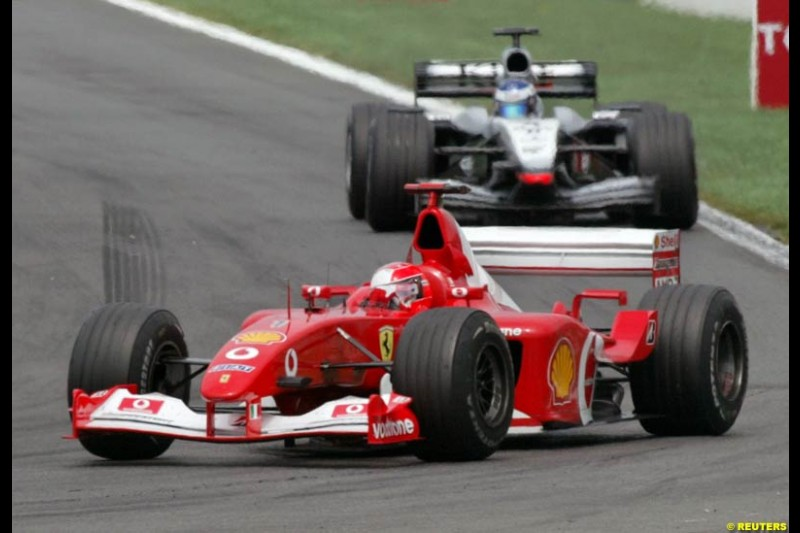 Michael Schumacher leads to win the French Grand Prix, Magny Cours, France, July 21st 2002.