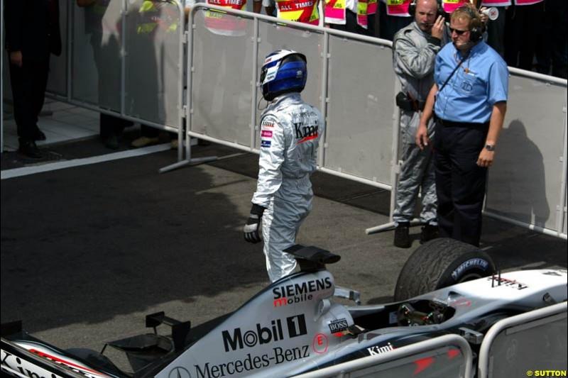 Kimi Raikkonen, McLaren, at parc ferme. French Grand Prix, Magny Cours, France, July 21st 2002.