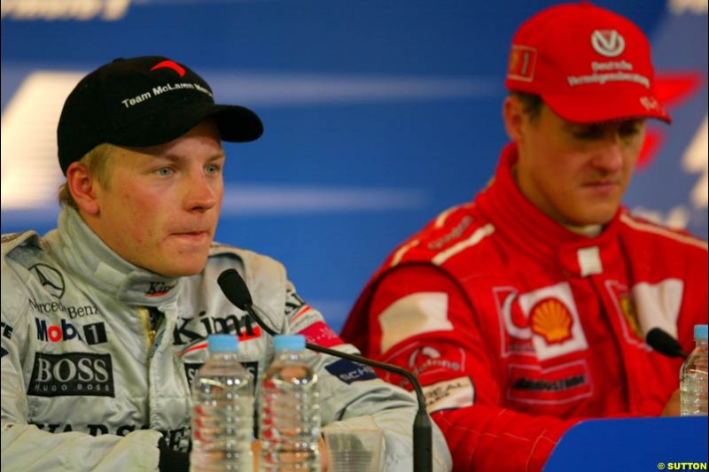 Kimi Raikkonen, McLaren, and Michael Schumacher, Ferrari, at the post race press conference. French Grand Prix, Magny Cours, France, July 21st 2002.
