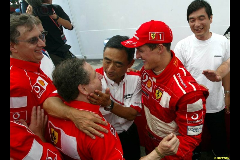 The Ferrari team and Bridestone president celebrate Michael Schumacher's 5th WC. French Grand Prix, Magny Cours, France, July 21st 2002.