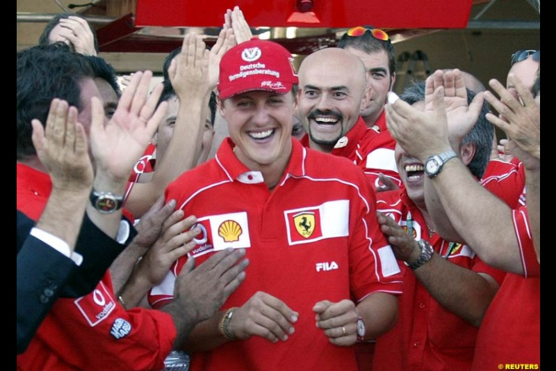 The entire Ferrari team, led by president Luca di Montezemolo, celebrate Michael Schumacher's 5th WC. French Grand Prix, Magny Cours, France, July 21st 2002.