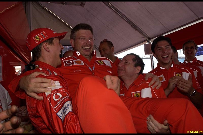 The entire Ferrari team celebrate Michael Schumacher's 5th WC. French Grand Prix, Magny Cours, France, July 21st 2002.