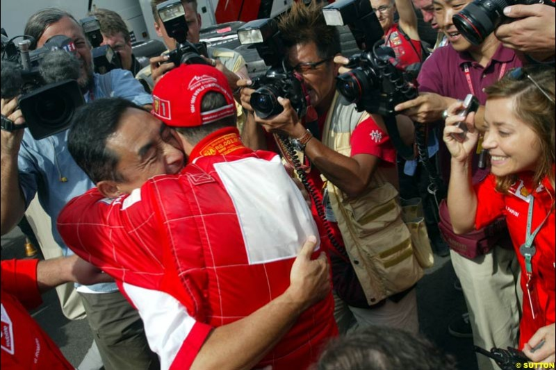 Bridgestone president celebrates with Michael Schumacher. French Grand Prix, Magny Cours, France, July 21st 2002.