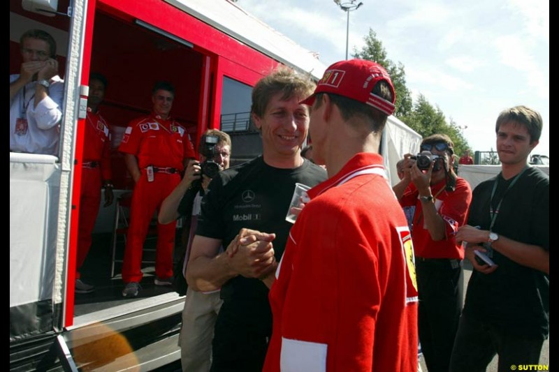 Mario Ilien of Ilmor Engines congratulates Michael Schumacher. French Grand Prix, Magny Cours, France, July 21st 2002.