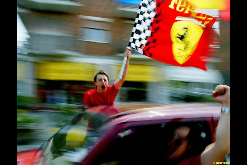 Fans celebrate Michael Schumacher's fifth WC. French Grand Prix, Magny Cours, France, July 21st 2002.