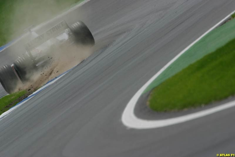 A British American Racing driver rides the curb. German Grand Prix, Hockenheim, Germany, July 27th 2002.