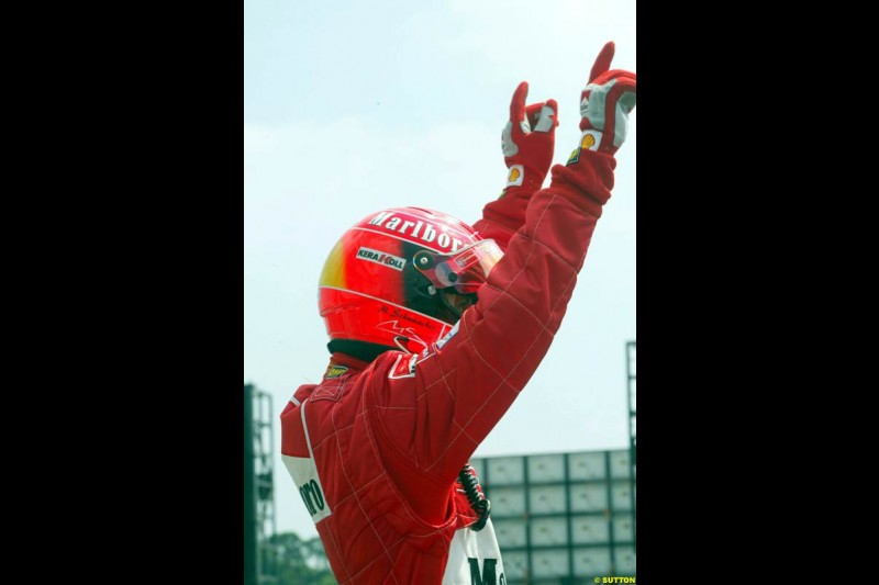 Michael Schumacher, Ferrari, celebrates claiming Pole Position in Qualifying. German Grand Prix, Hockenheim, Germany, July 27th 2002.