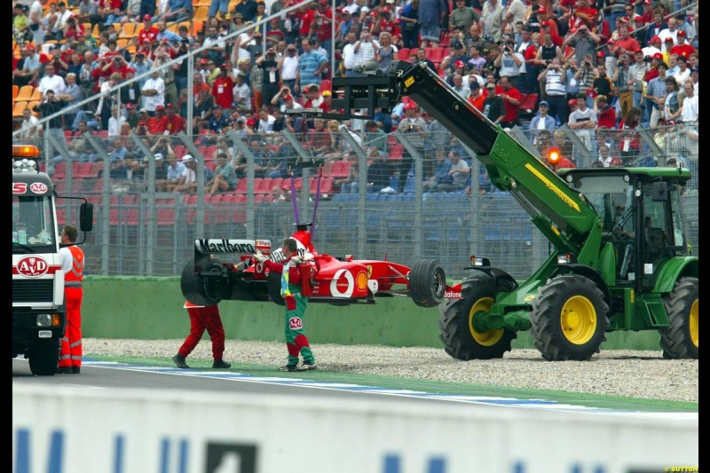 Rubens Barrichello's Ferrari is lifted from the track after a spin during Saturday Free Practice. German Grand Prix, Hockenheim, Germany, July 27th 2002.