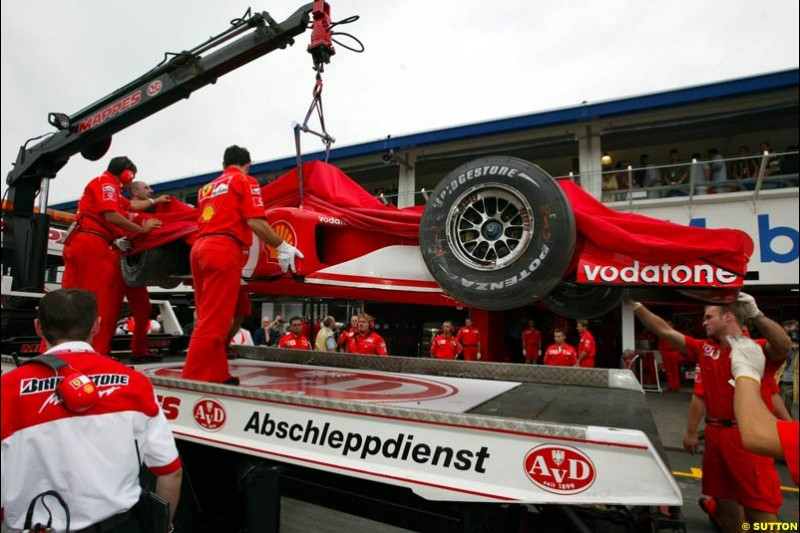 Rubens Barrichello's Ferrari arrives back at the pits during Saturday Free Practice. German Grand Prix, Hockenheim, Germany, July 27th 2002.