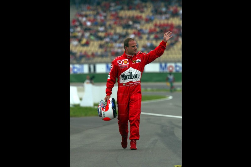 Rubens Barrichello, Ferrari, walks back to the pits after a spin during Saturday Free Practice. German Grand Prix, Hockenheim, Germany, July 27th 2002.