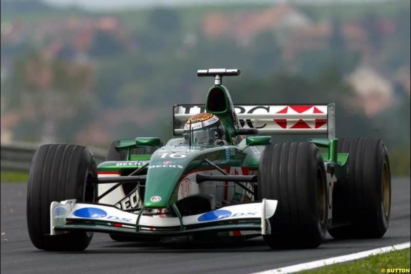 Eddie Irvine, Jaguar, during Friday free practice for the Hungarian Grand Prix, Hungaroring, Hungary, August 16 2002.