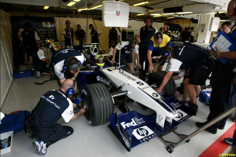 Ralf Schumacher (GER) Williams BMW FW24 in the pits. Hungarian Grand Prix, Budapest, 16 August 2002.
