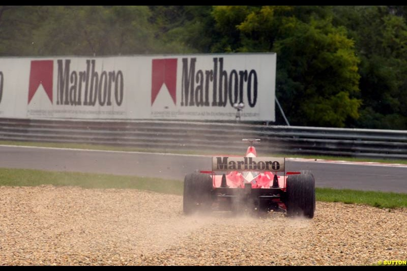 Rubens Barrichello (BRA) Ferrari F2002 runs into the gravel trap. Hungarian Grand Prix, Budapest, 16 August 2002.