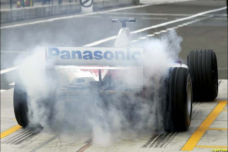 A Toyota TF102 lays down some rubber in the pits. Hungarian Grand Prix, Budapest, 16 August 2002.