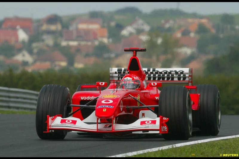 Michael Schumacher, Ferrari, during Friday free practice for the Hungarian Grand Prix, Hungaroring, Hungary, August 16 2002.